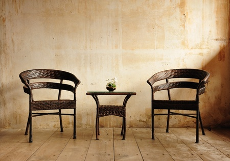 Two chairs against a beige wall Stock Photo - 10272908