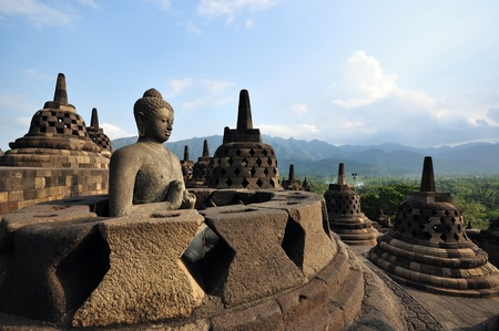 Buddha statue in stupa. Borobudur. Java. Indonesia
