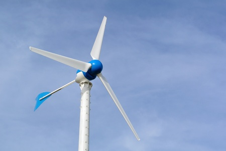 cropland: wind turbine generating electricity on blue sky