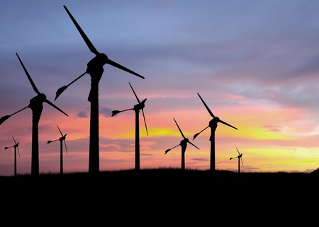 harmless: Silhouette of windmills with a sunset