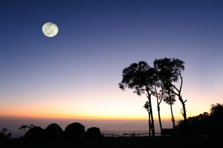 colourful sky: Camping on mountain in sunset and evening with moon Stock Photo