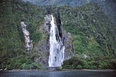 Waterfall at milford sound, New Zealand photo