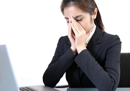 computer problem: Portrait of tired young business woman Stock Photo