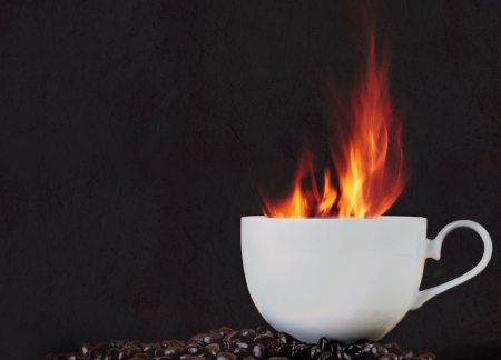 Fire hot coffee in white cup photo