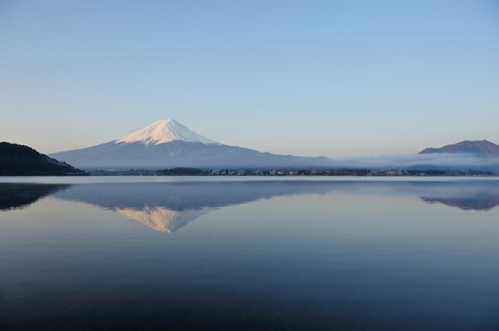 capped: Mt Fuji in the early morning with reflection on the lake kawaguchiko