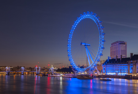 LONDON, UNITED KINGDOM - September 25: Night view of the South Bank of the River Thames including the world famous landmark, London Eye on September 25, 2014 in London