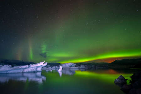 jokulsarlon: Jokulsarlon Glacial Lagoon at north light in the sky. Stock Photo