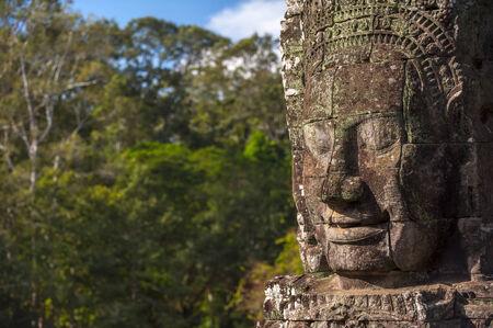 bayon: Ancient stone face of Bayon temple, Angkor, Cambodia Stock Photo