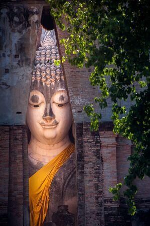 the big Buddha in Sri Chum temple the Sukhothai Historic Park Thailand photo