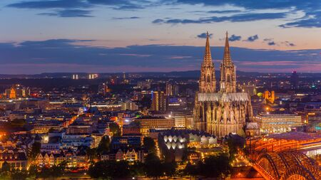 steeples: Bridge and the Dom of Cologne at night. Cologne, Germany