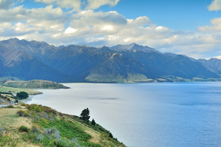 no snow: Blue Lake with Mountain Range and Blue Sky in South Island, New Zealand