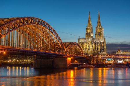 cologne: Bridge and the Dom of Cologne at night. Cologne, Germany