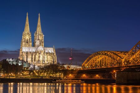 german: Bridge and the Dom of Cologne at night. Cologne, Germany
