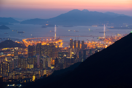 icc: Top view from The lion rock park, sunset onver Kowloon and Hong kong sky. Stock Photo