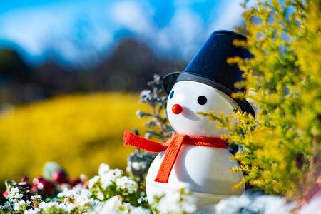 Snowman doll outdoors