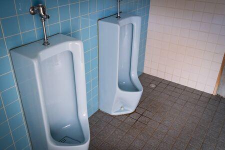 Photo of dirty men's public toilet