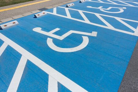 Photo of parking lot for disabled people. Wheelchair Parking.