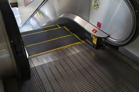 Photo of an unmanned escalator indoors