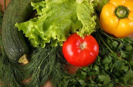 Vegetables - dill salad tomato pepper squash close-up. 免版税图像