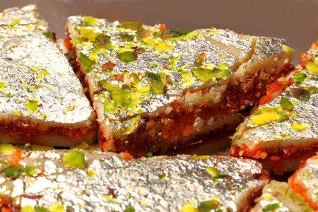 pista: three layeder indian sweet called sangam barfi made from layers of cashewpistachio nuts and chocolate