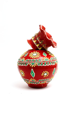 two pieces: a decorated red colored flower vase made of clay broken into two pieces