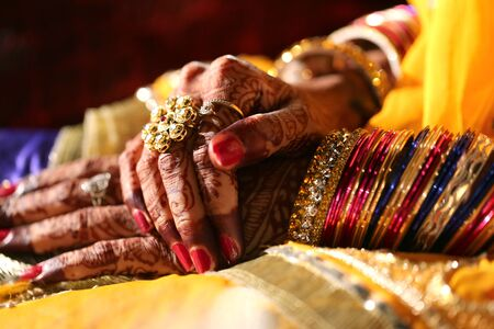 aciculum: brides hand showing bangles and wedding ring