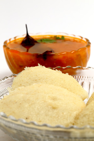 almost all: Idli - Sambhar an Indian food typically made in South India but liked and prepared almost in all parts of India, beautifully plated  in a glassware, isolated on white