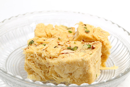 indian sweet: Sohan Papdi - an indian sweet beautifully place in a glass bowl isolated on white