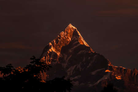 Snowy mountain of Nepal- Mt. Fishtail. Amazing close-up view of Mt. Fishtail from Pokhara, Nepal during evening. This mountain is also called virgin mountain as it is not allowed to climb there.
