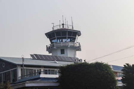 Pokhara, Nepal- November 17 2019: View of Air Traffic Control Tower in a Pokhara Airport of Nepal with beautiful airport scene.