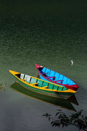 Boats are being kept aside in a Fewa Lake by boaters due to COVID-19 pandemic effect. Boats are parked due to corona virus threat for boater to do their daily job.