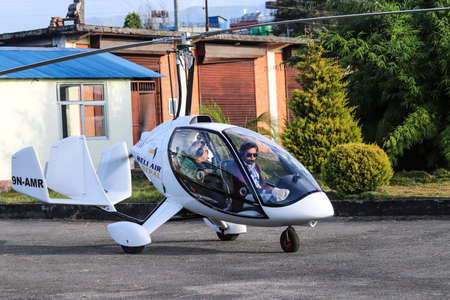 Gyrocopter ready to take off from a Pokhara Airport during a morning.