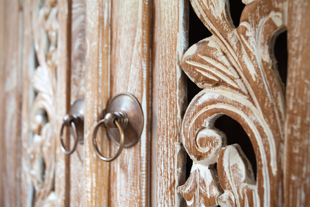 Furniture in classic Balinese style details light wood with carved patterns for use as background