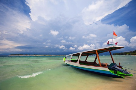 Old traditional fishing boats on the beach on the background of storm clouds. Bali, Indonesia Stock Photo