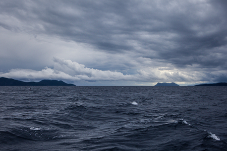 natural moody: A stormy sea with dark clouds and Islands, Greece