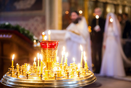 Burning candles on the background of weddings in the Orthodox Church Stock Photo