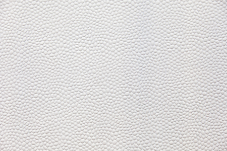 styrene: Plastic convex textured white background with round shapes