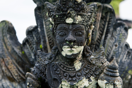 terrifying: Stone sculpture on entrance door of the Temple in Bali Tirta Gangga, Indonesia Stock Photo
