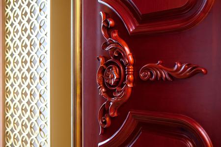 Carved wood texture doors mahogany interior element Stock Photo