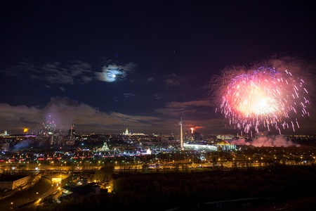 pyrotechnics: Bright fireworks explosions in night sky in Moscow, Russia