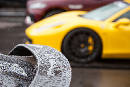 aftermarket: Rain drops on the spoiler of a sports car Stock Photo