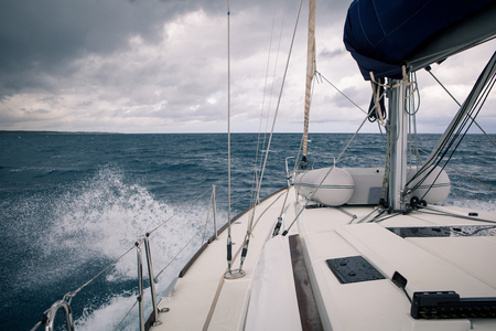 Sailing yacht during a storm, the view from the bow of the ship