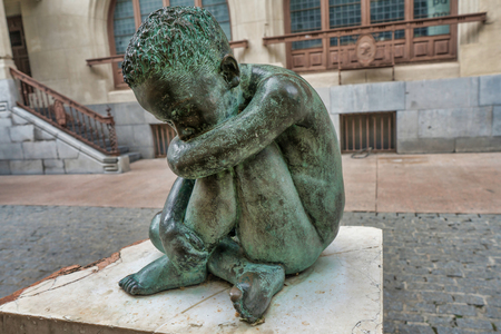 Sad Child bronze sculpture in the middle of Vitoria-Gasteiz, Spain.