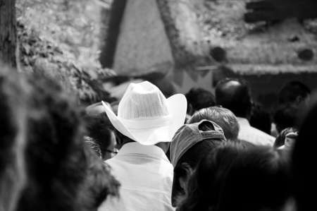 alone in crowd: Hat