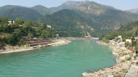Beautiful Ganges river flows through mountains in India.