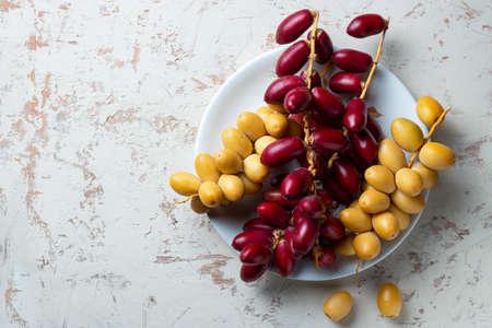fresh dates fruit in white plate