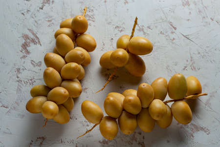 fresh dates fruit on texture white background 免版税图像