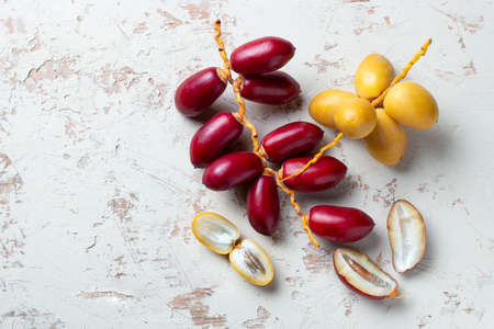 yellow and red fresh dates fruit isolate on white background 免版税图像