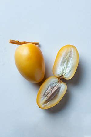 yellow fresh dates fruit isolate on white background