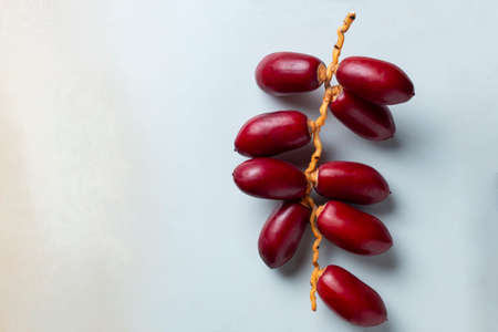 red dates fruit on white background
